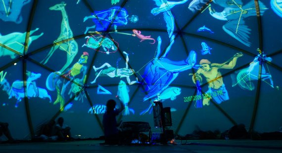 Images including men, women and animals projected onto a blue background