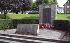 The war memorial in the Wilmslow Memorial Gardens following the service at which wreaths and individual flowers were placed.