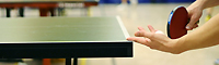 Somebody playing table tennis