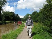 Walker on canal towpath