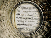 Photograph inside a glass on a dictionary over the word magnify