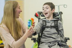 disabled child with carer