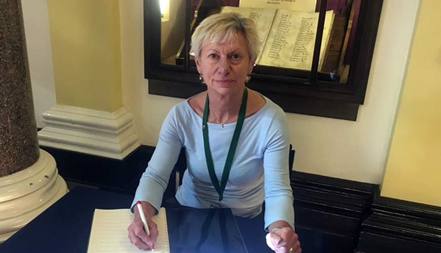 Councillor Rachel Bailey sat with a book of condolence